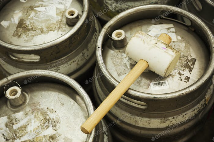 Metal beer kegs and a solid hammer to hammer in the airtight bungs.