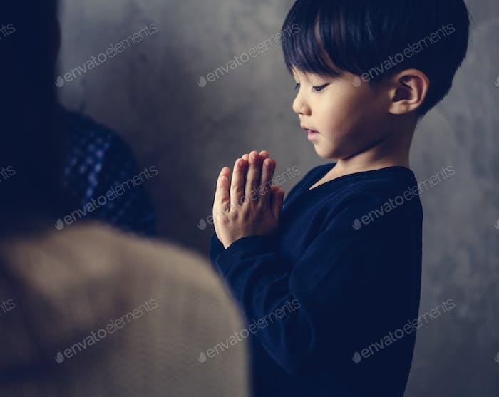 Japanese boy praying