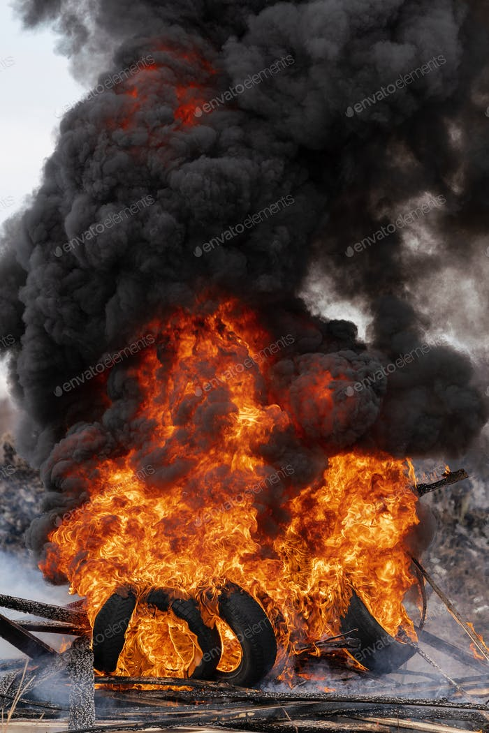 Burning Automobile Tires, Strong Flame of Red Fire and Clouds of Black Fumes