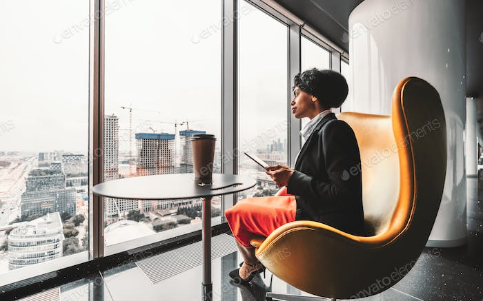 A business lady on a yellow armchair