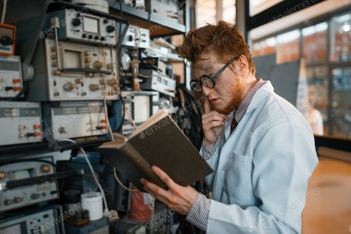 Strange engineer with book, test in laboratory