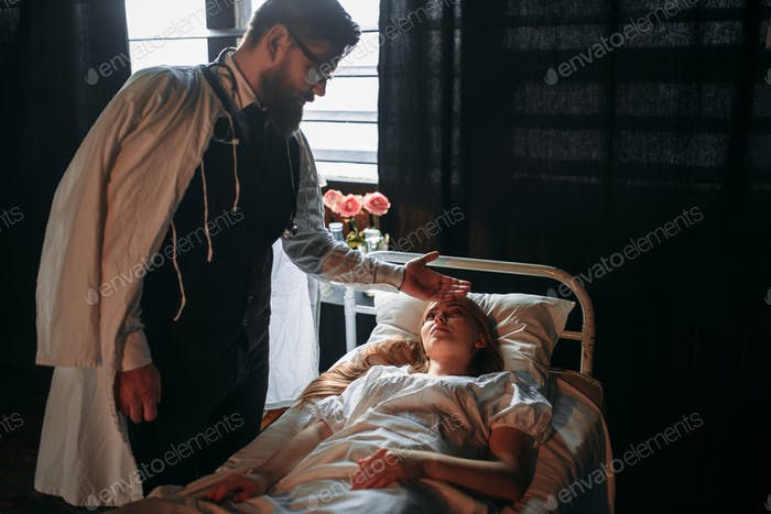 Male doctor touching the forehead of sick woman