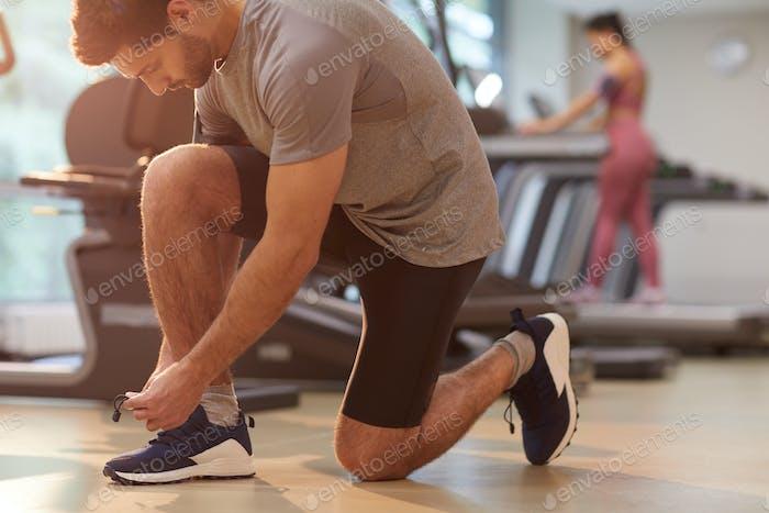 Sportive Man Tying Shoes