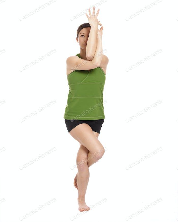 woman doing eagle position