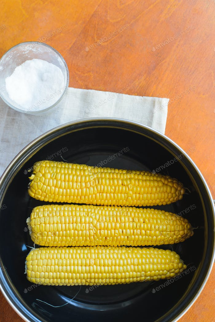 Cooking corn in a pan in the kitchen