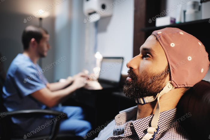 Health Care Professionals Working In Hospital with EEG