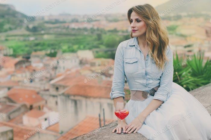 Young woman drinking apiritif