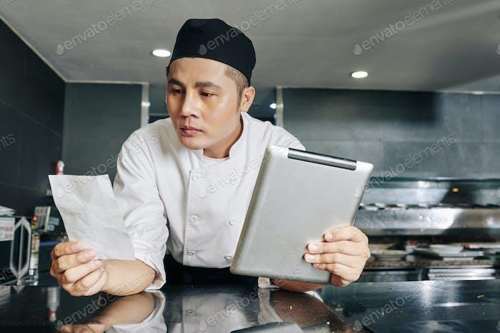 Chef reading a recipe