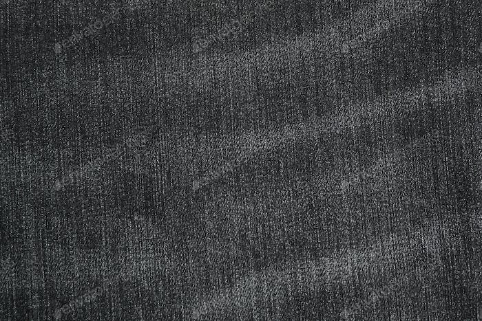 Texture of black jeans as background, space for text