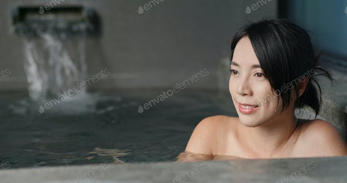 Asian woman enjoy onsen
