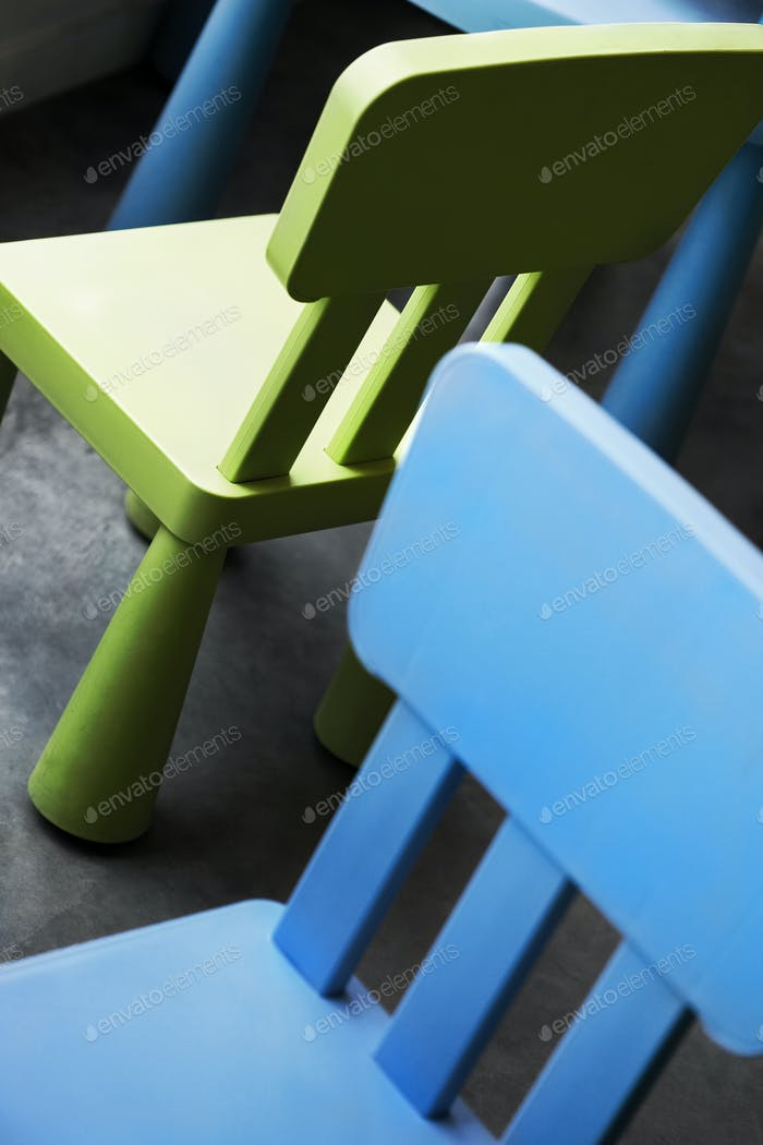 Blue and green small chairs in a nursery