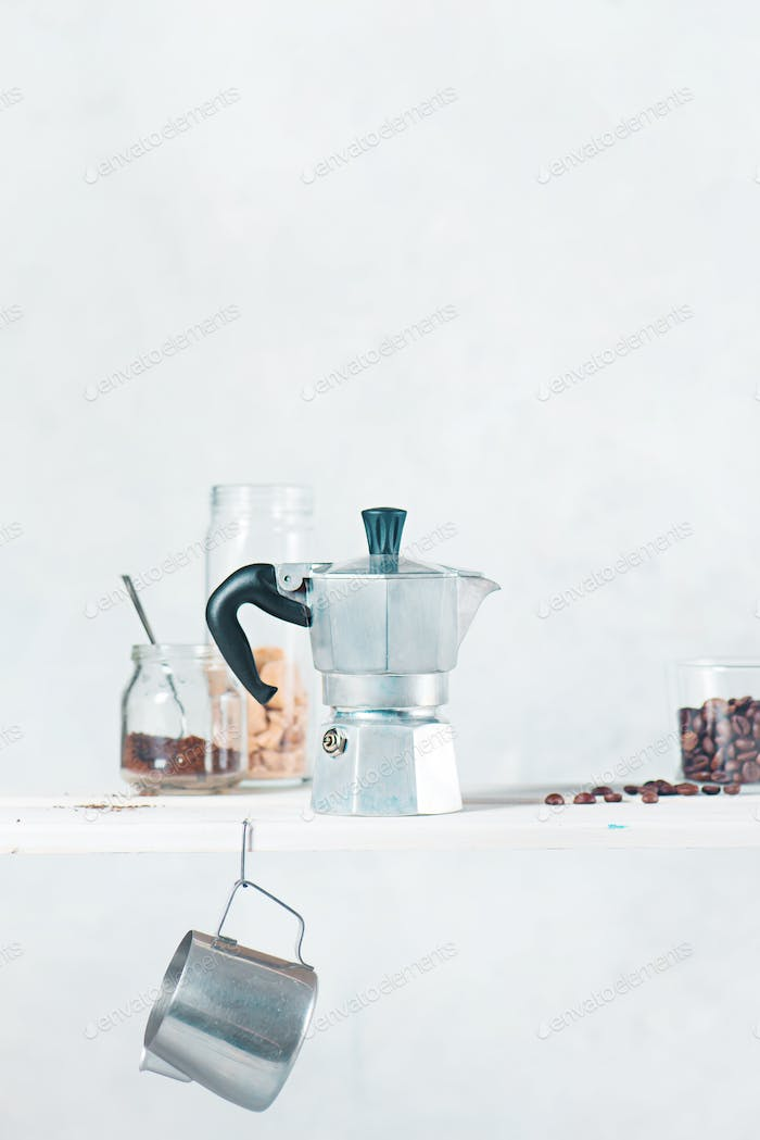 High key drink photography with Italian geyser coffee maker on a shelf with coffee brewing