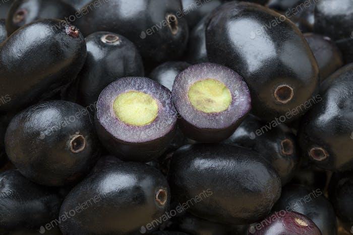 Fresh black Jamun berries full frame and halved ones