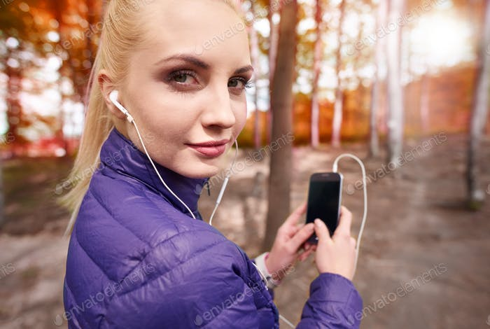 Woman with phone turning to the camera