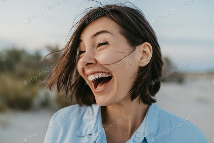 smiling portrait of candid laughing woman