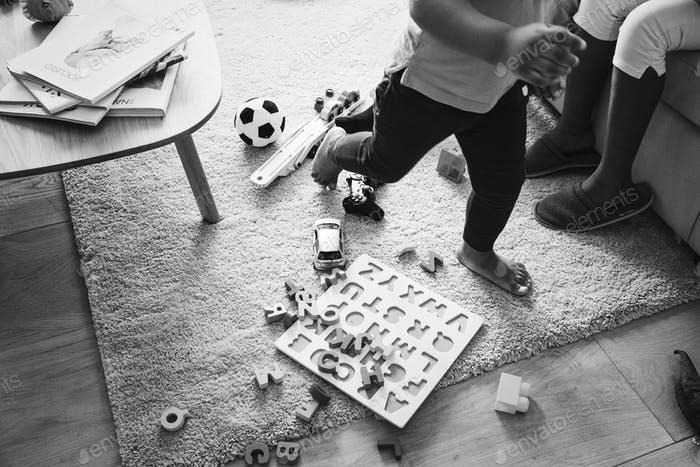 Kids playing toy in living room