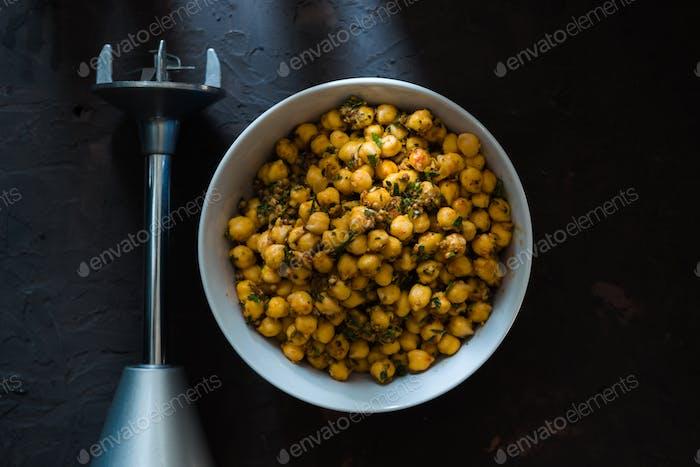 Chickpeas in a ceramic bowl and blender for falafel