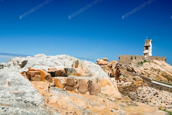 view of pink rocks and Paon Lighthouse in Brehat