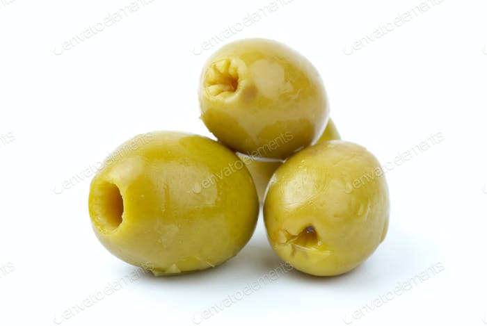 Three pitted marinated green olives close-up
