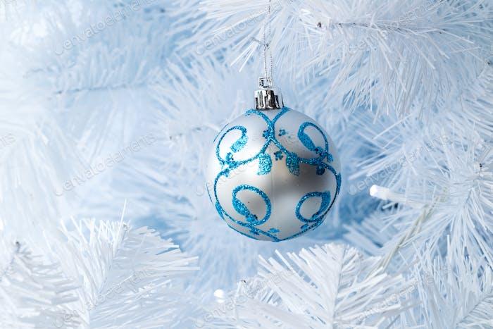 Christmas tree decorations hanging on a Christmas tree