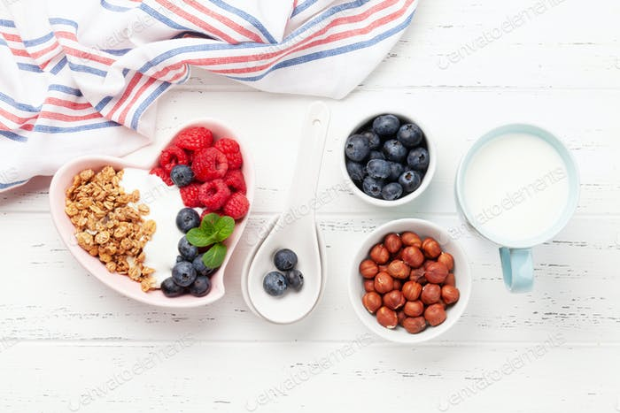 Healthy breakfast with granola, yogurt and berries