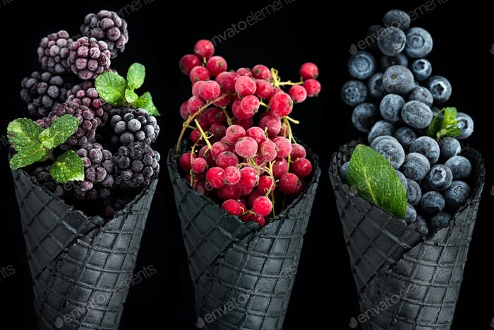 Ice cream cones filled with frozen berry fruits