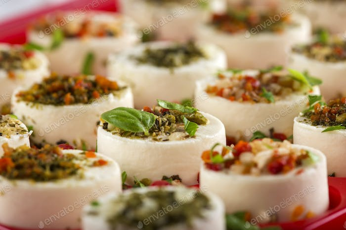fresh appetizers cheese with vegetables and basil