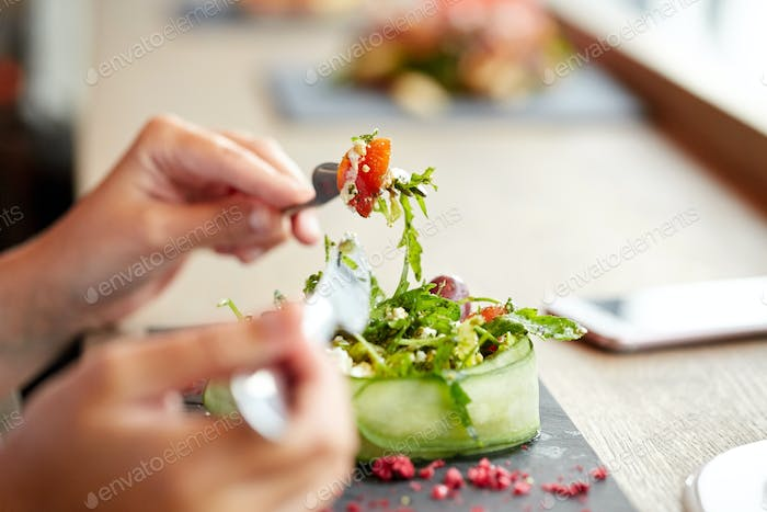woman eating cottage cheese salad at restaurant