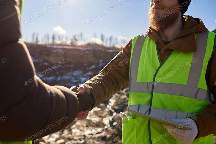 Miner Shaking Hands with Foreman