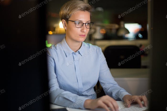 Pretty Manager Working on Computer