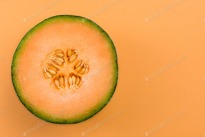 Cantaloupe Orange Melon Sliced in Half on Pastel Background