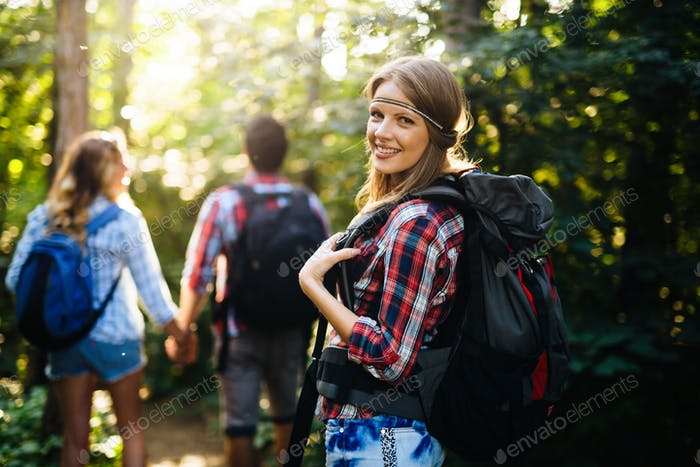Thumbnail for Group of backpacking hikers going for forest trekking