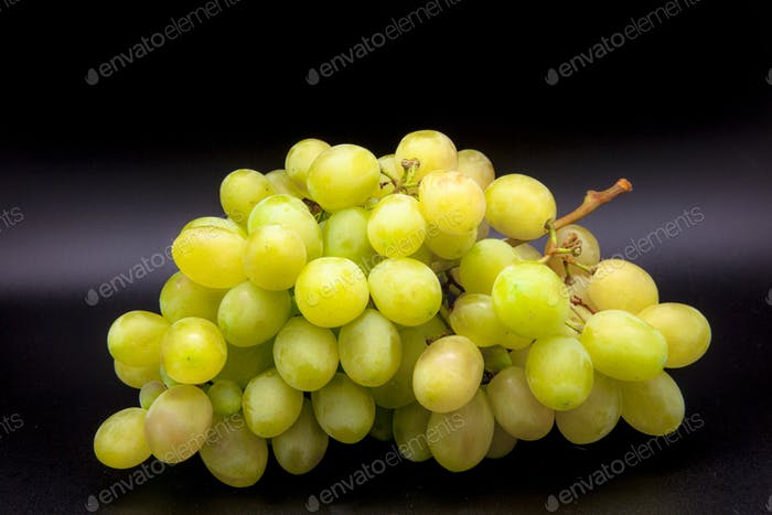 Grapes on black background