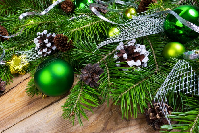 Christmas holiday greeting background with green ornaments