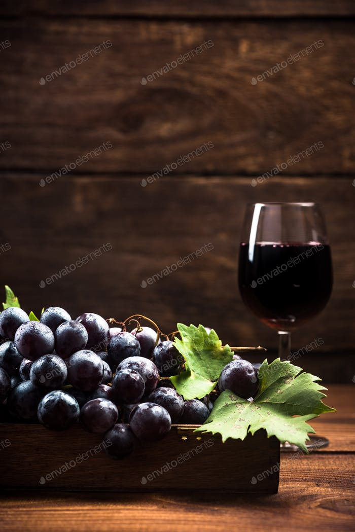 Fresh vine grapes and glass of red wine
