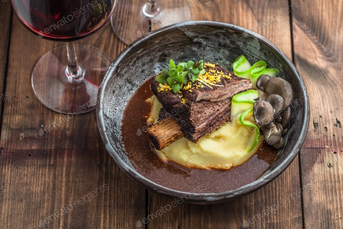 Slowly stewed beef short ribs with potato, mushroom and gravy.