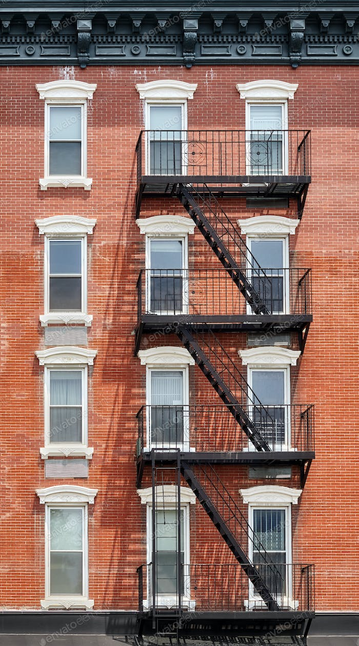 Old brick building with fire escape, New York City, USA.