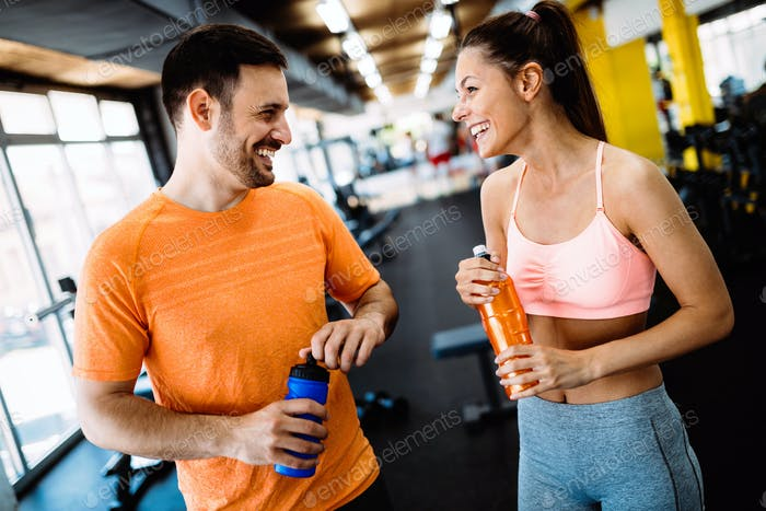 Happy couple in a health club