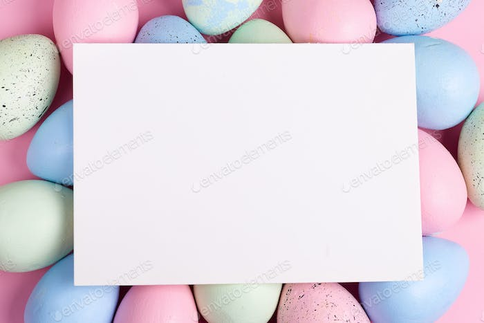 Happy Easter greeting card from handmade painted colorful eggs and paper sheet for congratulation