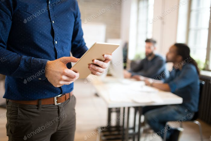 Young businessman using tablet in coworking office
