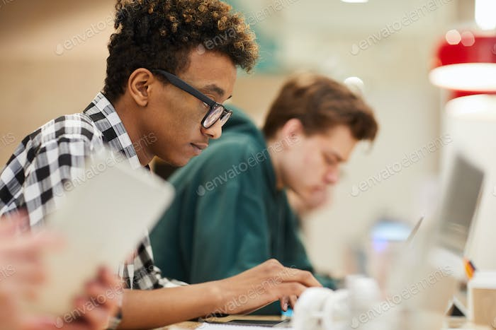Black student concentrated on coding