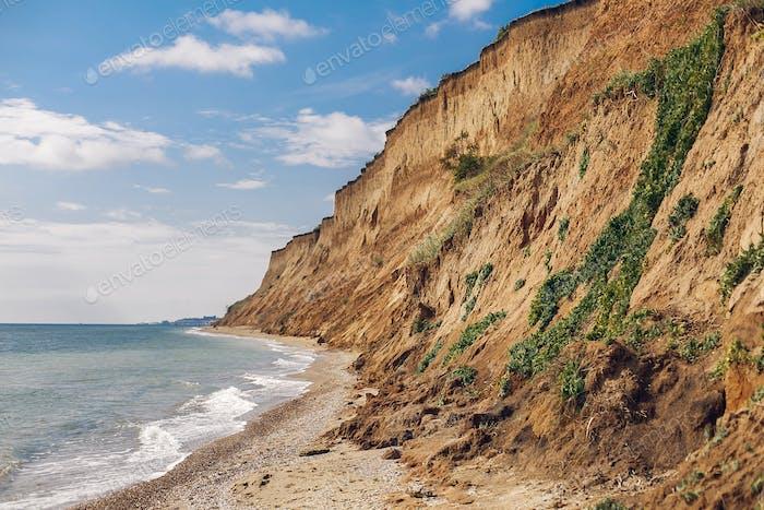 Beautiful view of sandy cliff near sea beach