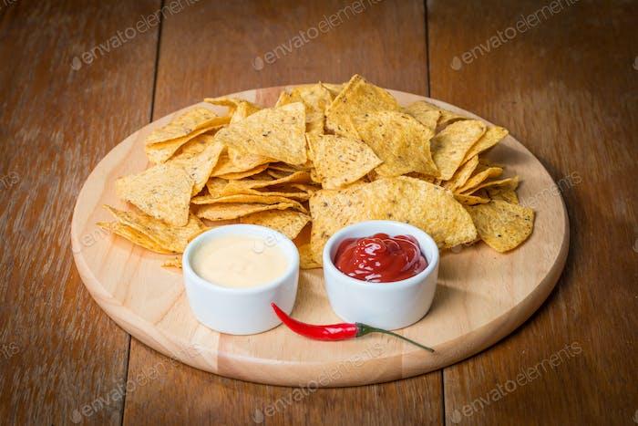 nachos with various sauces
