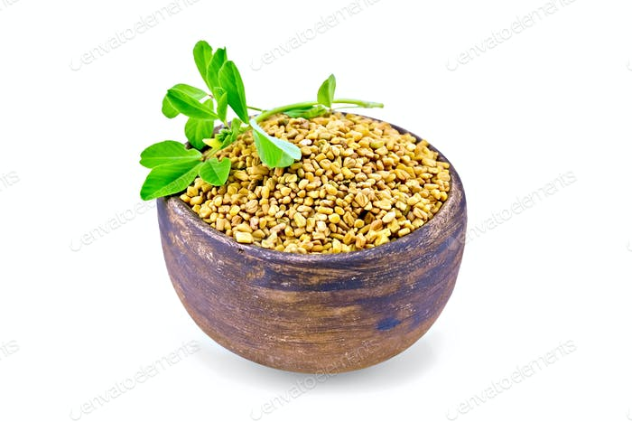 Fenugreek with leaf in clay bowl
