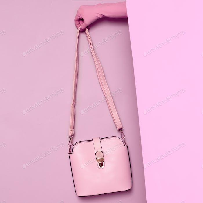 Stylish clothes. Minimal fashion. Pink Lady's bag for summer. Wa