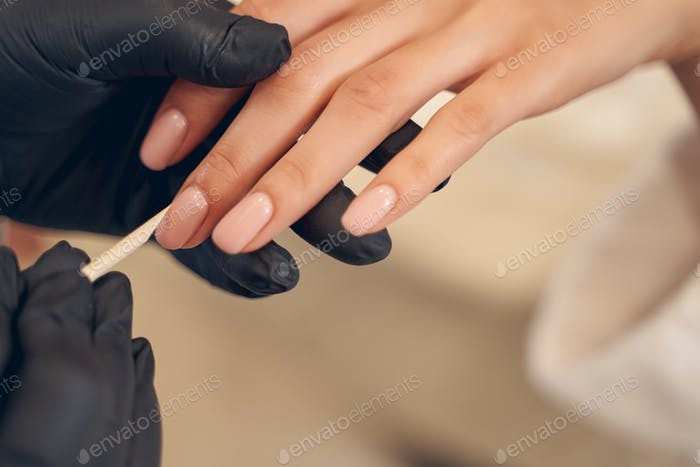 Nail care procedure handled by salon specialist
