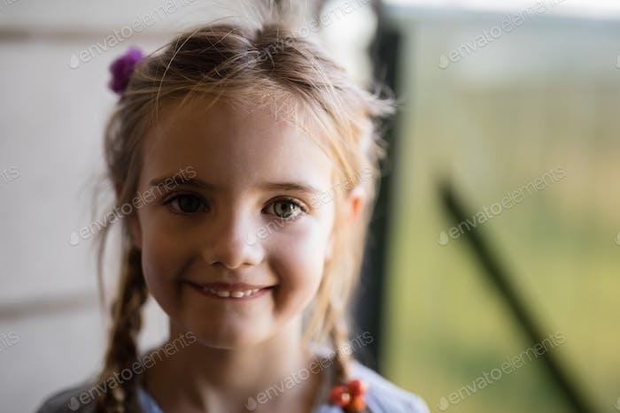 Smiling cute girl looking at camera