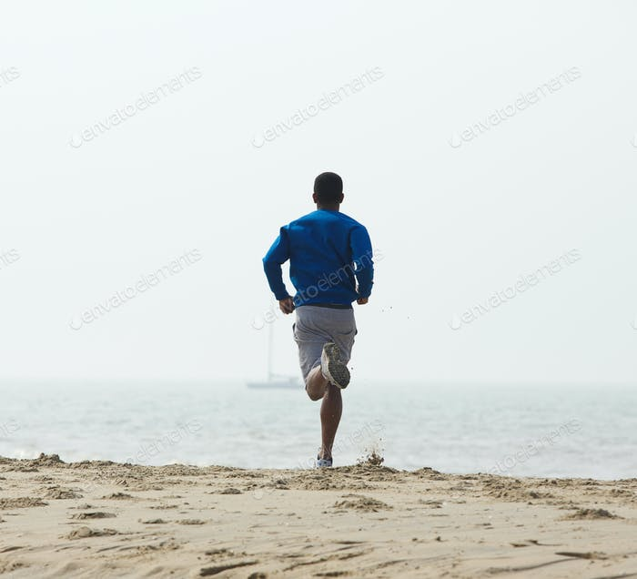 Rear view african american man jogging
