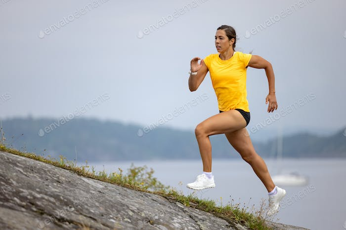 Athlete Sprinting On Mountain During Outdoor Workout