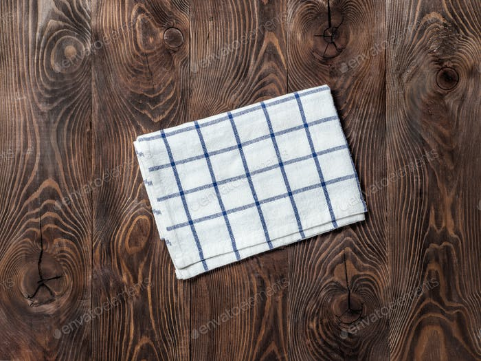 linen napkin on wooden table, top view, mock up